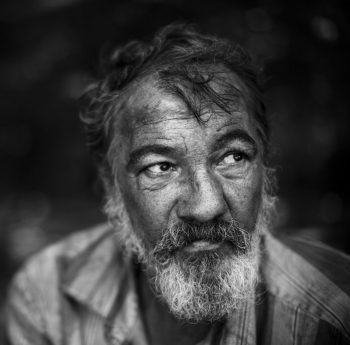 Homeless man on dark background